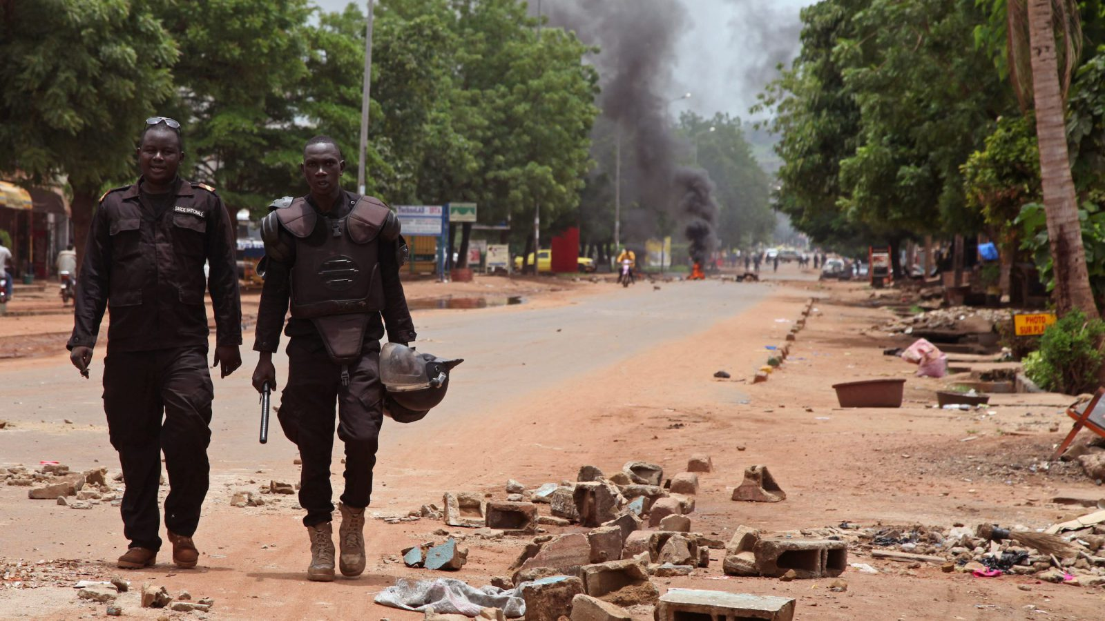 mali-police-walk-among-the-debris-after-a-protest-in-bamako-mali-e1471596074924